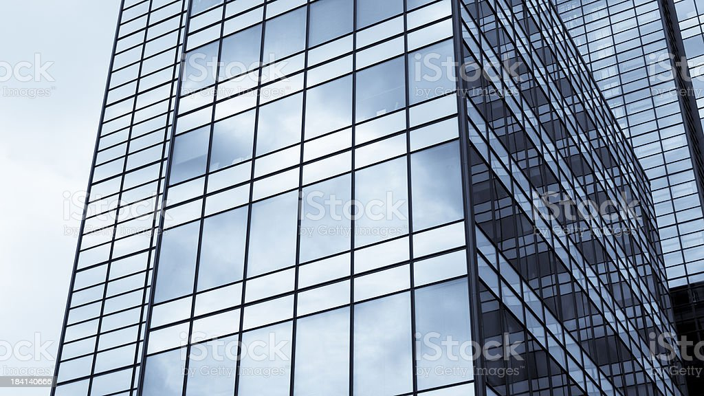 Office building with clouds reflected in windows royalty-free stock photo