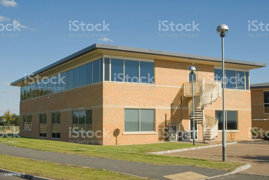 Office building with light pole royalty-free stock photo