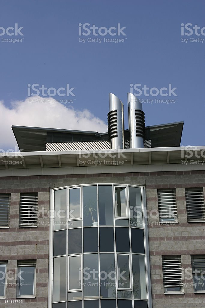Office building with smoke pipe stock photo