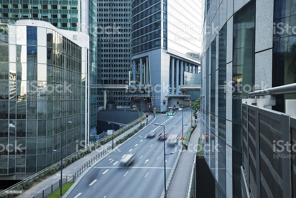 \'street with motion blurred cars in a financial district La Defense,...