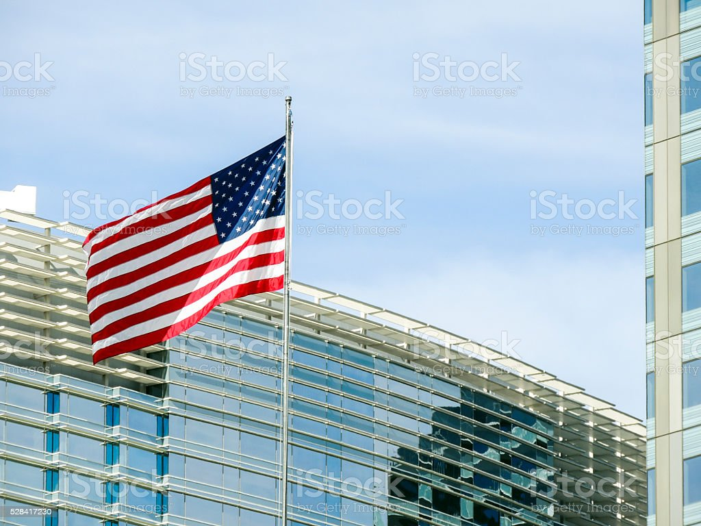 Office buildings and the US flag stock photo