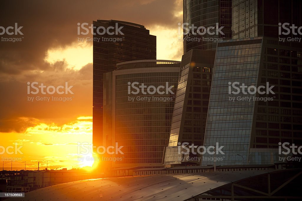 Office Buildings at sunset with dramatic sky royalty-free stock photo