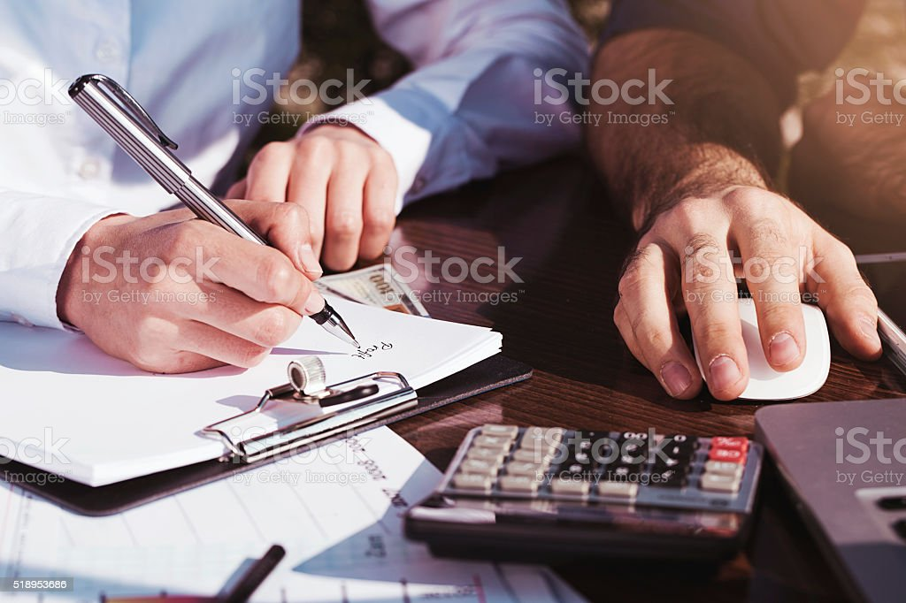 Office, business tools with dollars and calculator on table stock photo