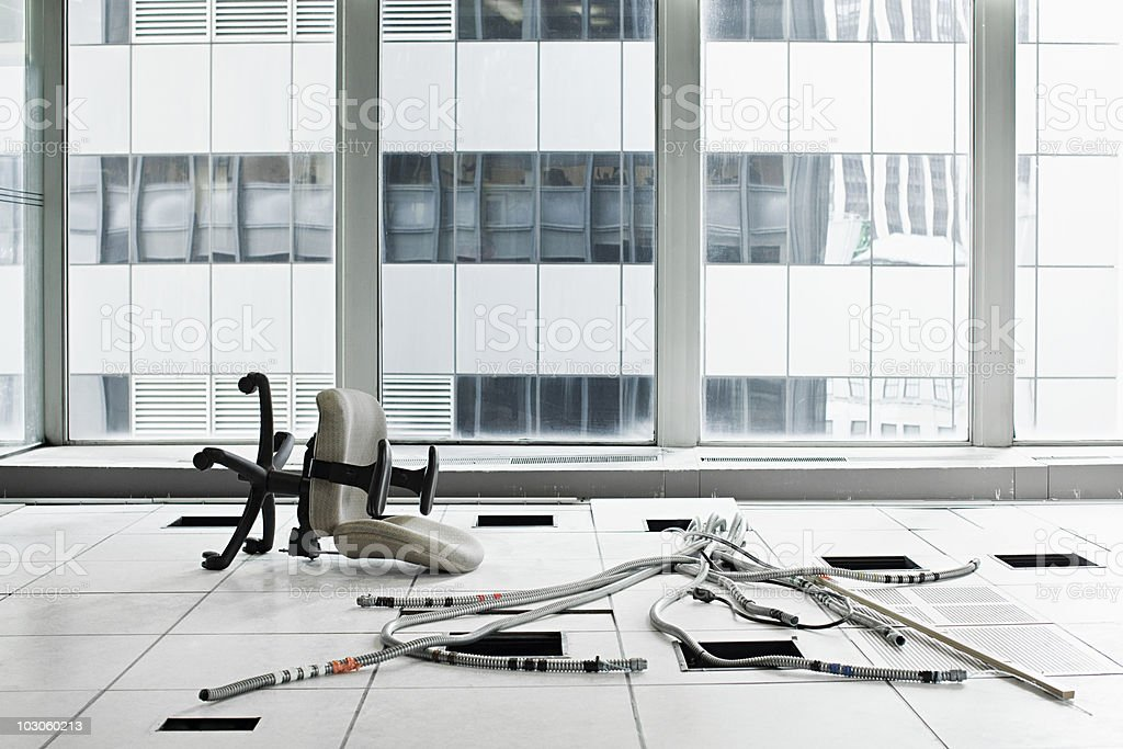 Office chair and cables on floor stock photo