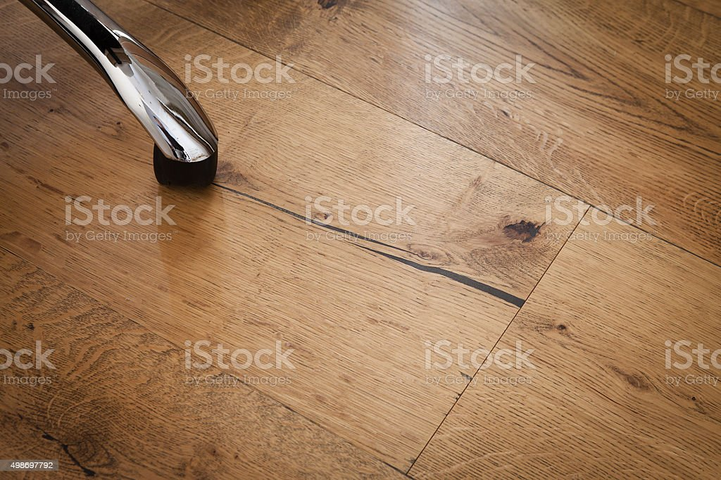 Office chair over a rustic oak flooring stock photo