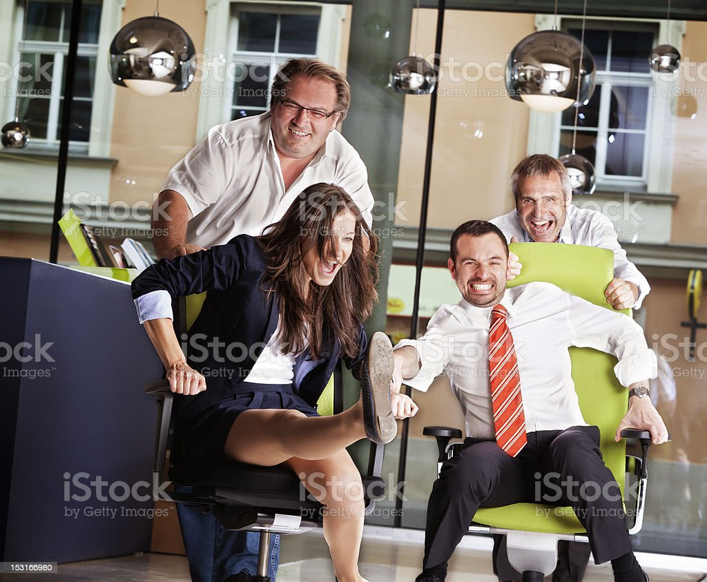 Office chair race at work royalty-free stock photo