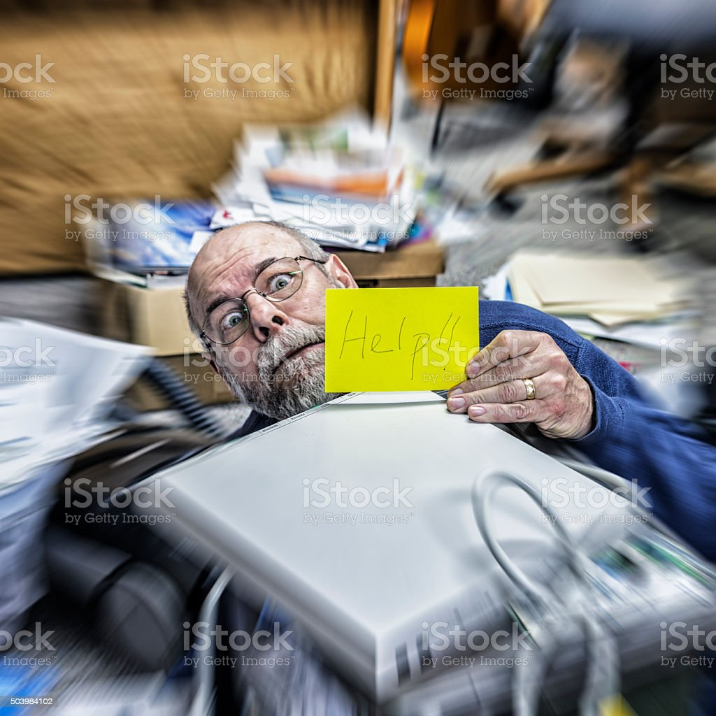 Office Chaos Panic Senior Adult Man Holding Help Sign stock photo