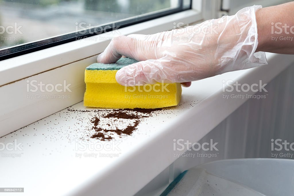 Office Cleaning Concept human Hand cleaning Window sill stock photo