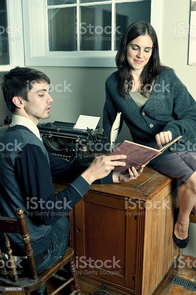 Office clerk chatting with young woman (retro) royalty-free stock photo