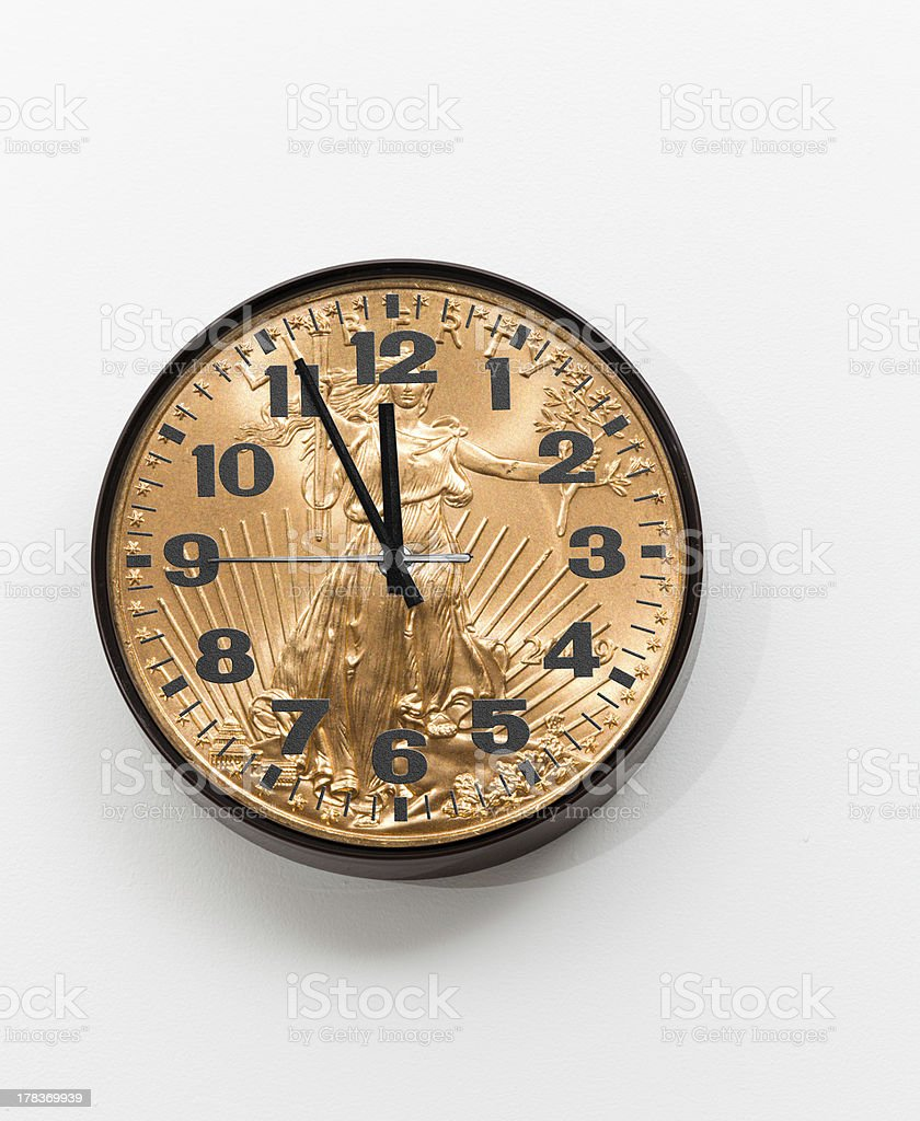 Office clock with gold coin as face for concept stock photo