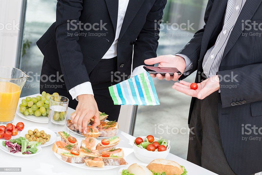 Office colleagues at buffet royalty-free stock photo