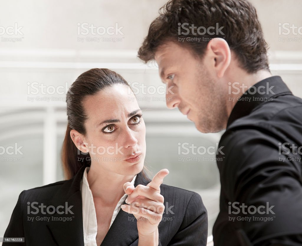 Office conflict business woman bully scolding and harrasing a worker stock photo