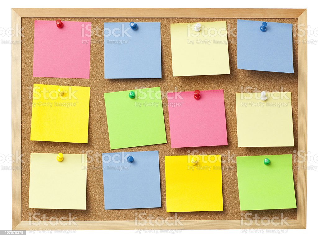 Office cork board full of colored memo notes. royalty-free stock photo