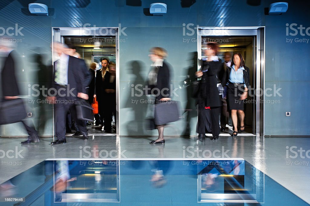 Office Corridor During Morning Rush Hour stock photo