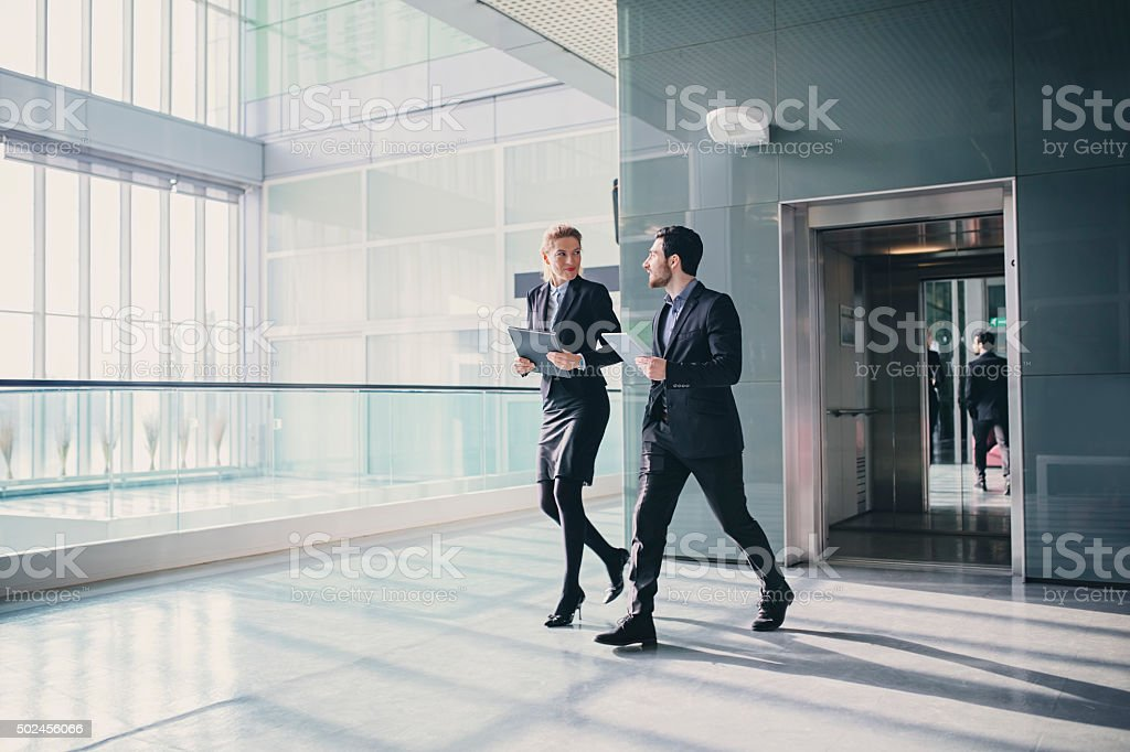 Office Corridor with elevator During Morning Rush Hour stock photo