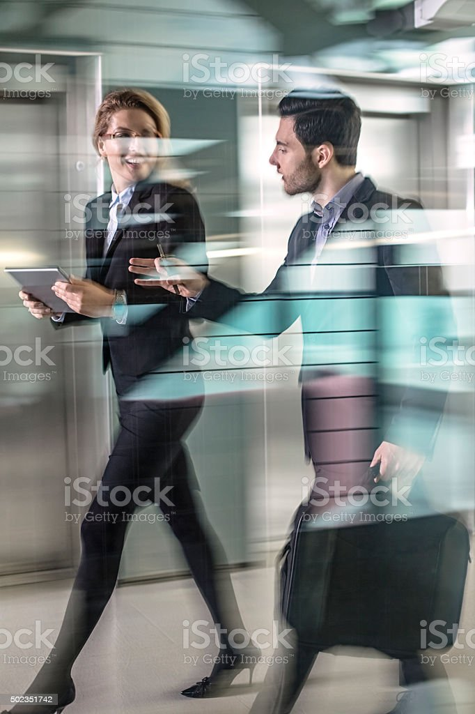 Office Corridor with elevators  During Morning Rush Hour stock photo