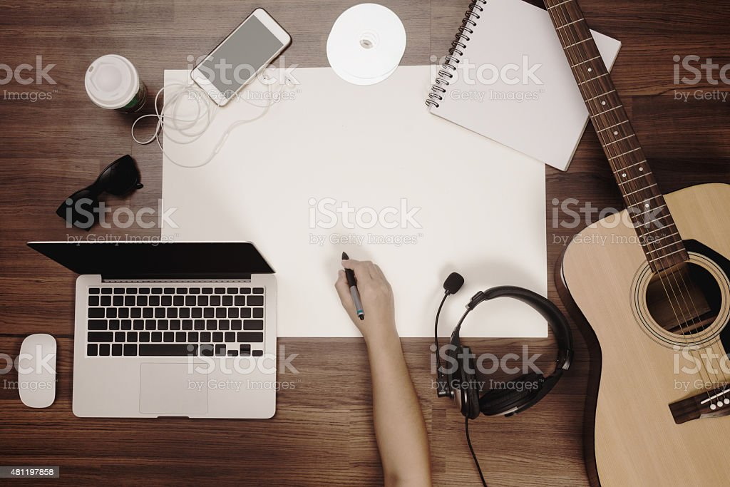 Office desk background hand drawing on poster with acoustic guitar stock photo