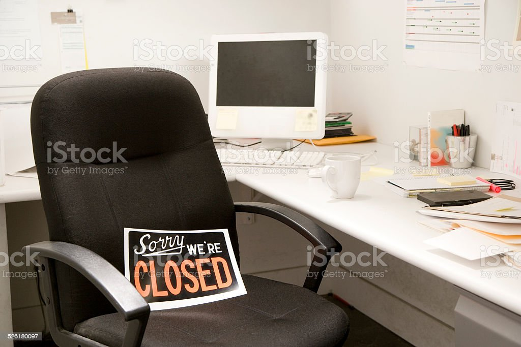Office Desk Chair With Closed Sign stock photo