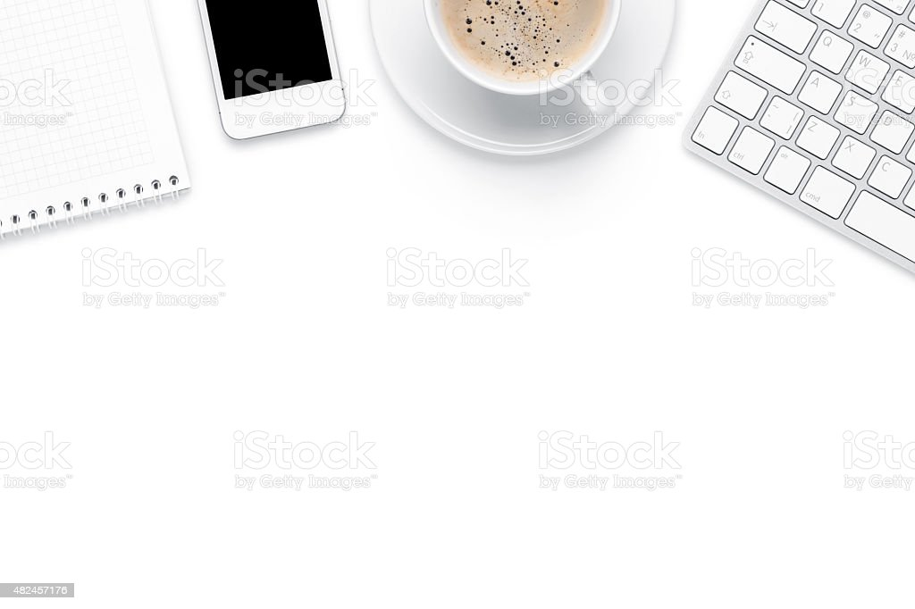 Office desk table with computer, supplies and coffee cup stock photo