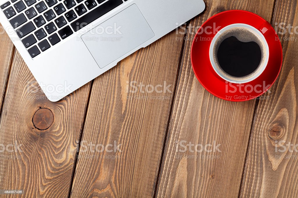 Office desk table with laptop computer and coffee cup stock photo