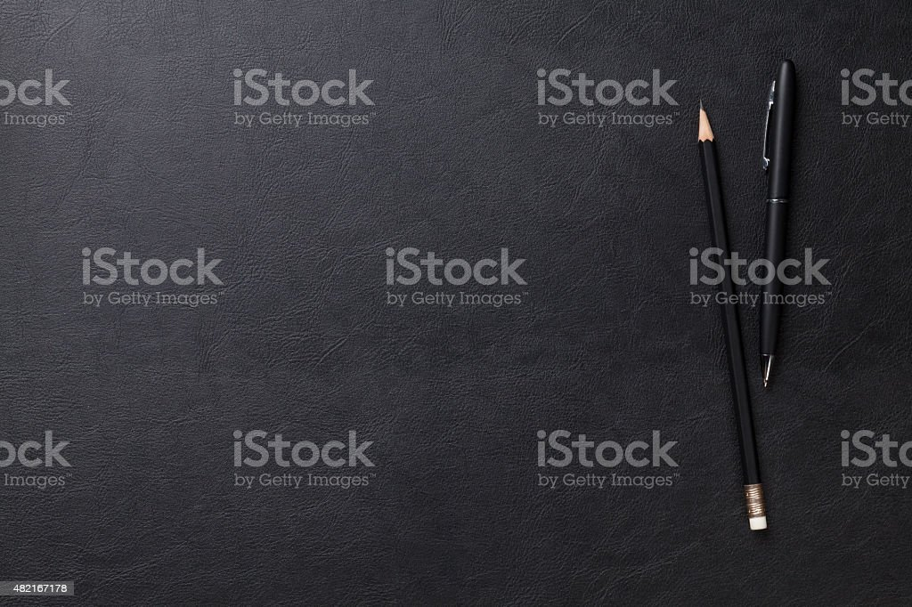 Office desk table with pen and pencil stock photo