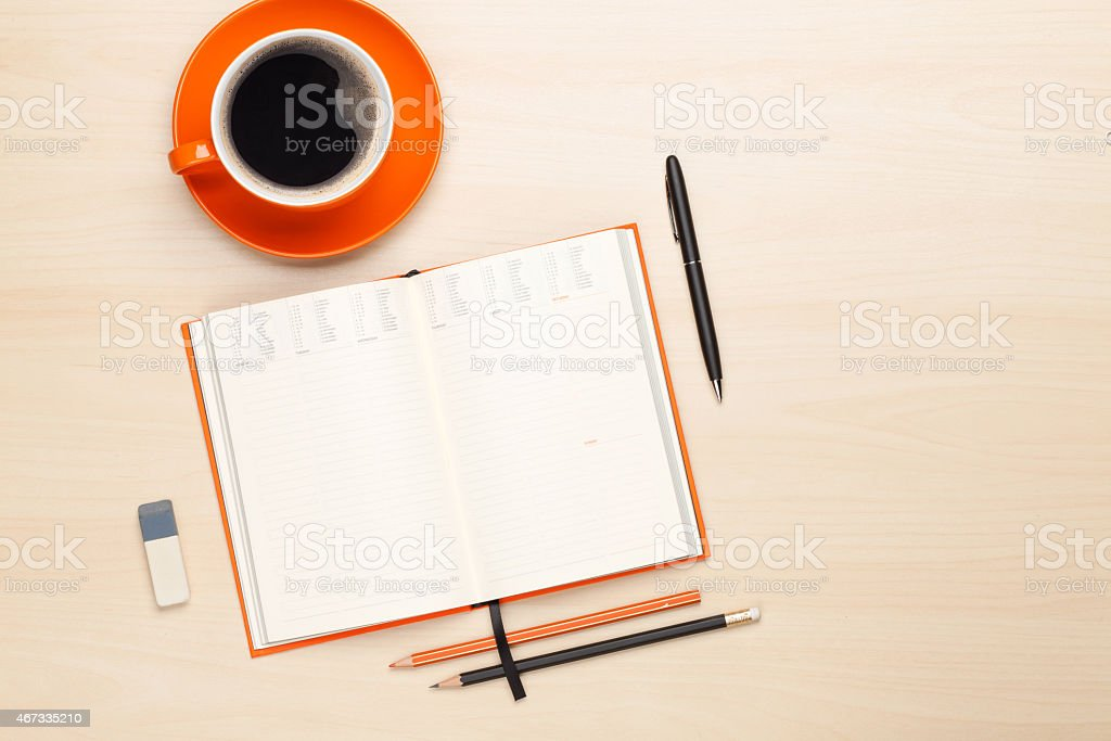 Office desk table with supplies and coffee cup stock photo