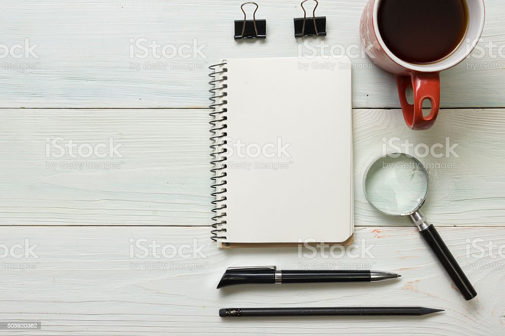 Office desk table with supplies and coffee cup. Top view stock photo