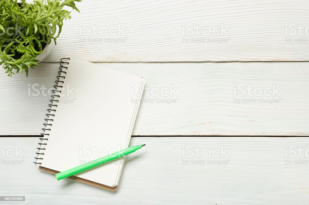 Office desk table with supplies and crumled paper. Top view stock photo