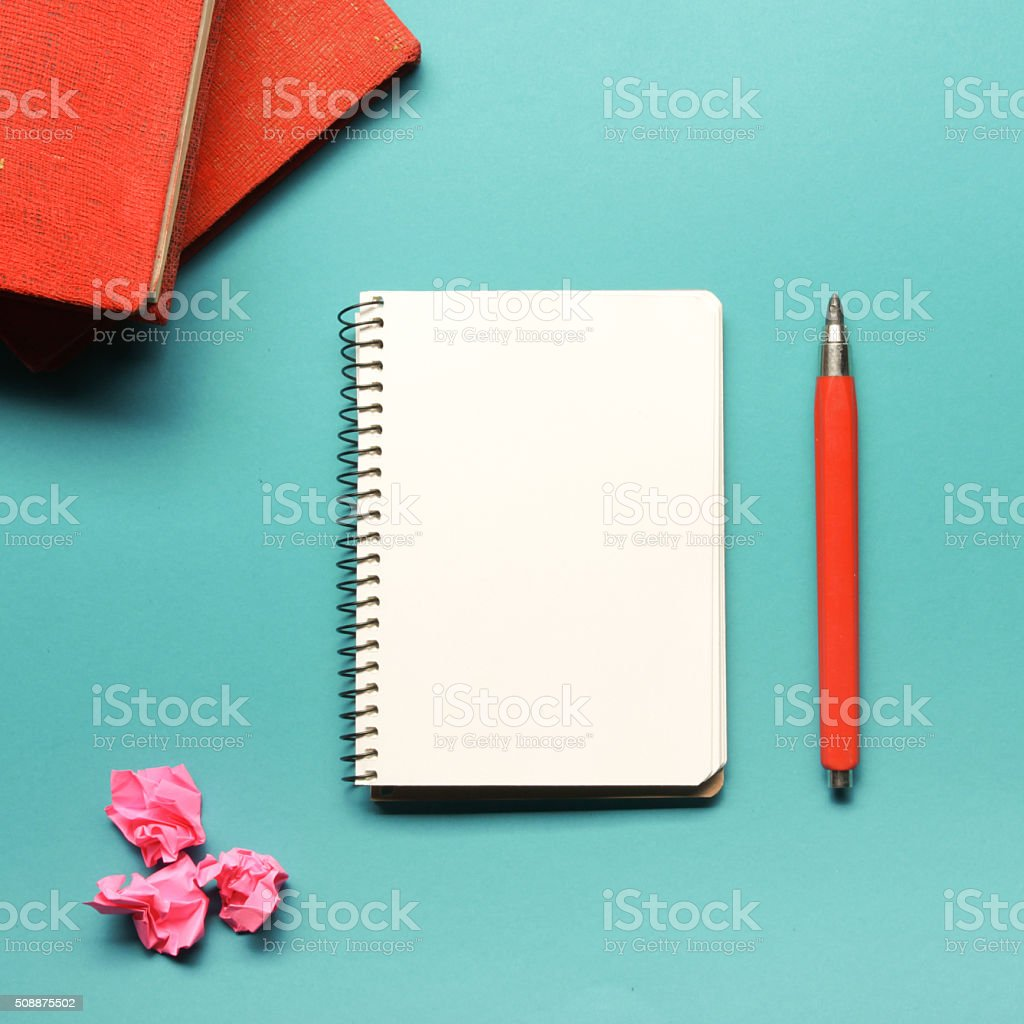 Office desk table with supplies and crumpled paper. Top view stock photo