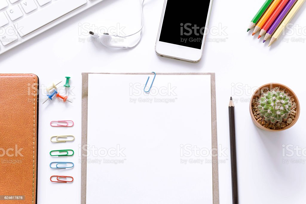 Office desk top view with smartphones, laptop and book stock photo