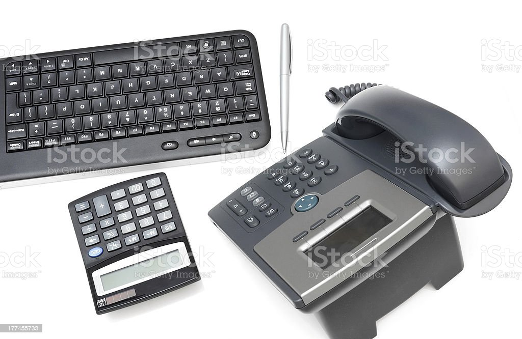 office desk with calculator,telephone,keyboard royalty-free stock photo