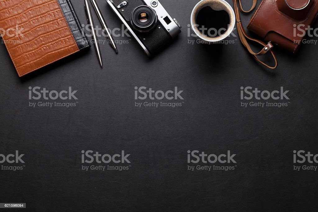 Office desk with camera, coffee and notepad stock photo
