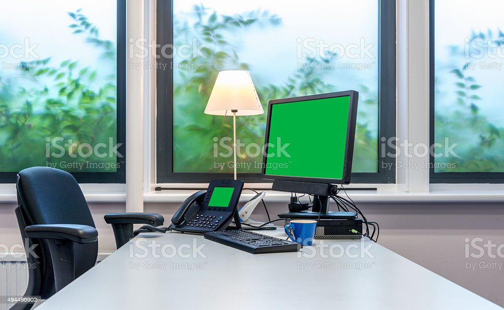 Office desk with chroma key monitor screen stock photo