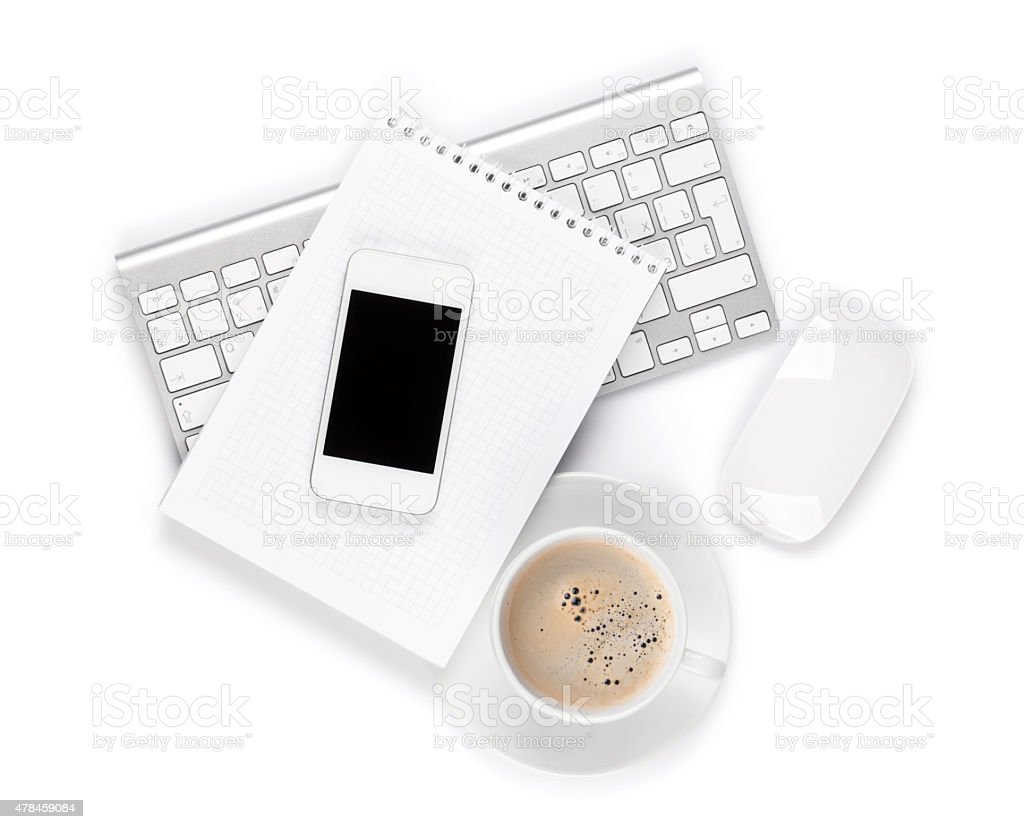 Office desk with computer, supplies and coffee cup stock photo