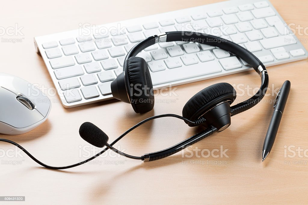Office desk with headset. Call center stock photo