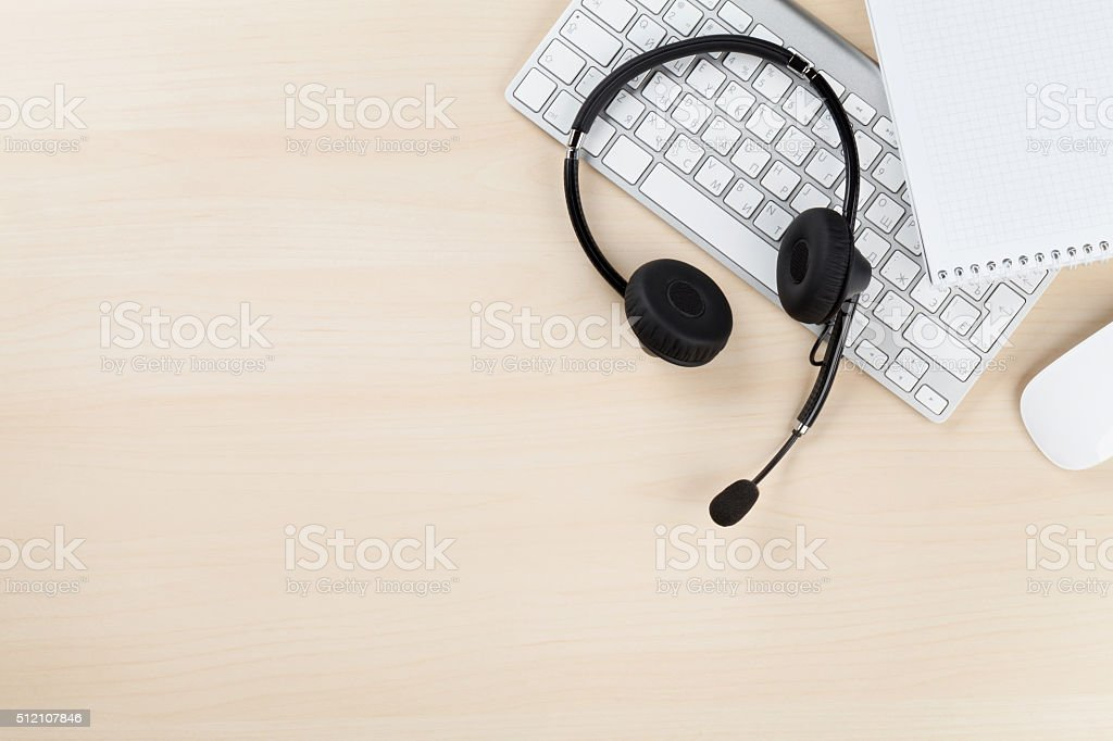 Office desk with headset. Call center support stock photo