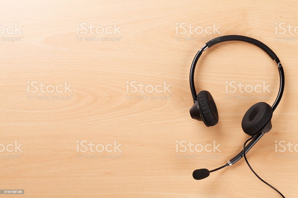 Office desk with headset. Call center support table stock photo