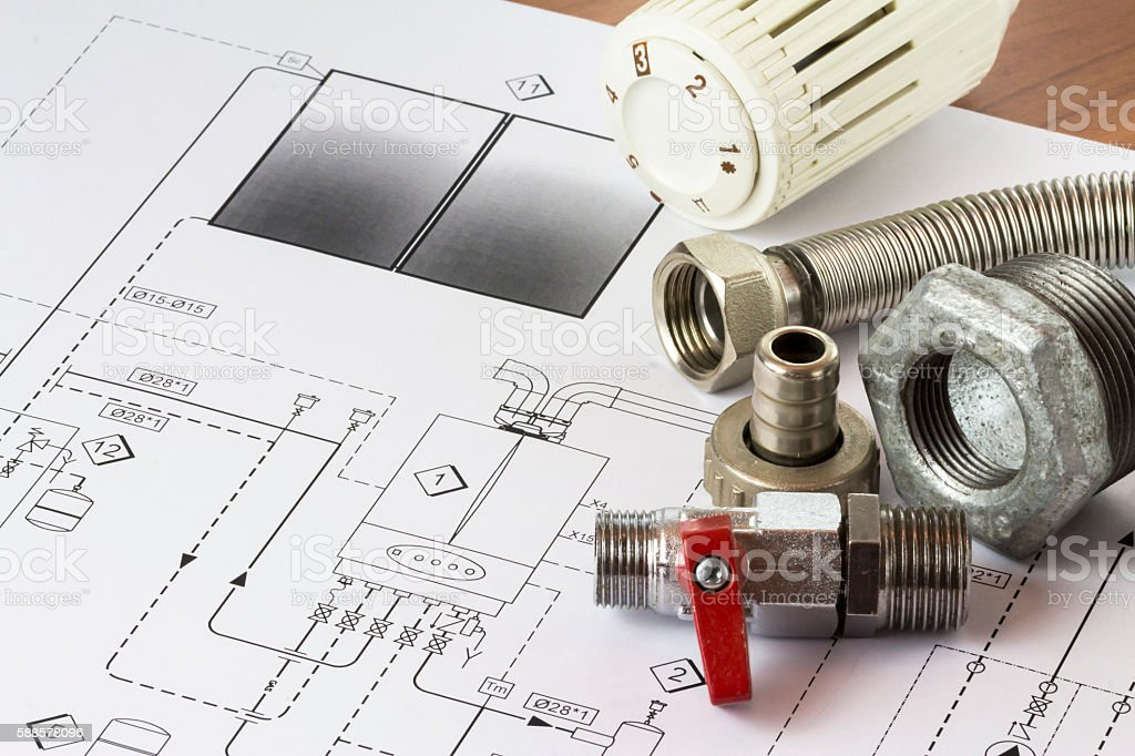 Office desk with hydraulic fittings and project stock photo