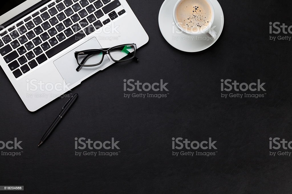 Office desk with laptop and coffee cup stock photo