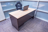 Office desk with note book and chair.