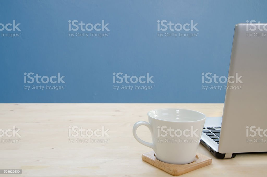 Office desk with notebook and coffee cup. stock photo