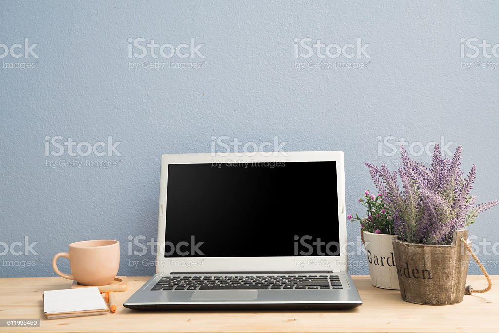 Office desk with office supply and flower pot. stock photo
