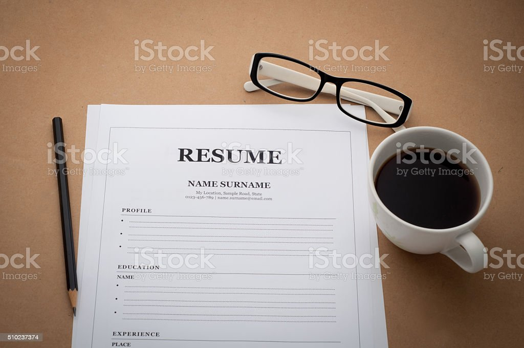 office desk with resume information, Coffee cup, black pencil an stock photo