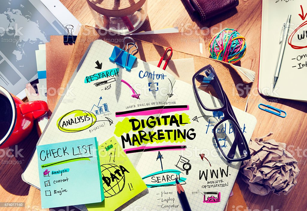 Office Desk with Tools and Notes About Digital Marketing stock photo