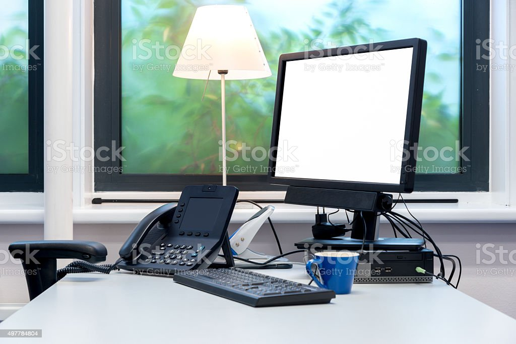 Office desk with white monitor screen stock photo