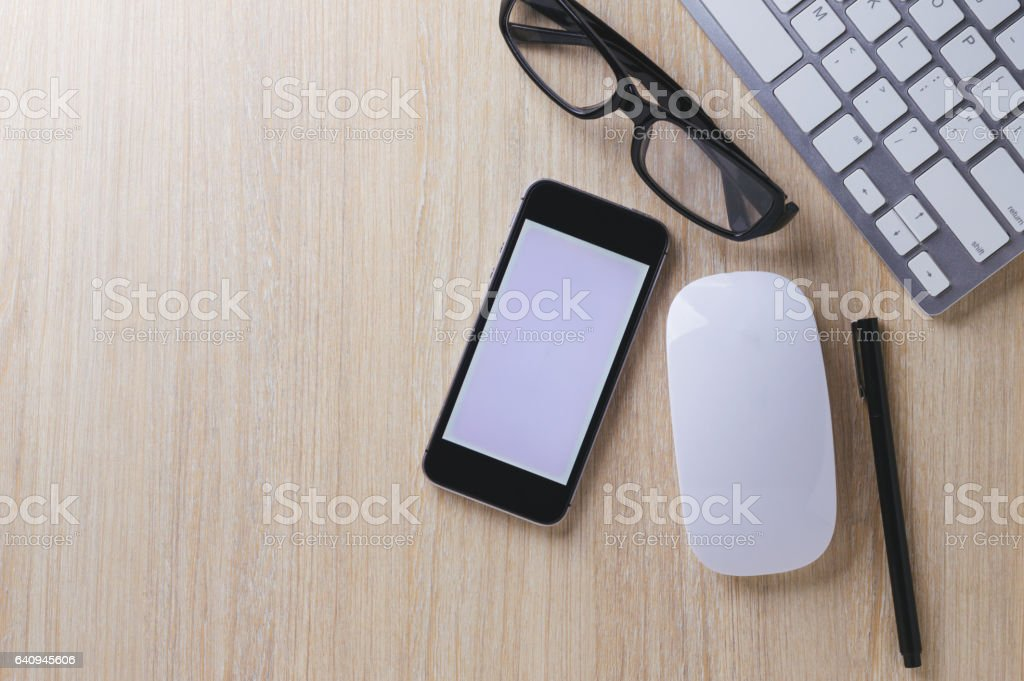 Office desk wood with computer, note book,phone concept in wood background.Copy space. stock photo