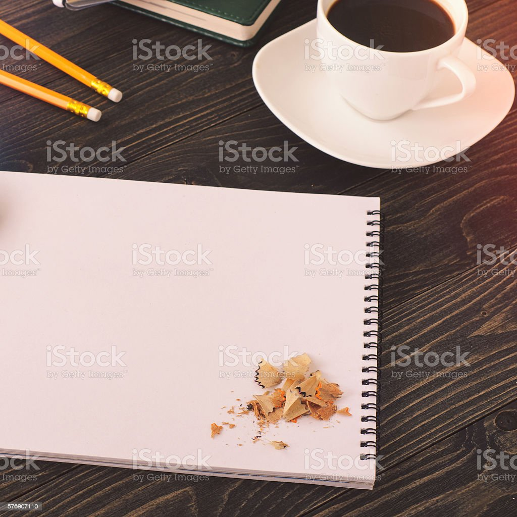 Office desktop with notebook and cup of coffee stock photo
