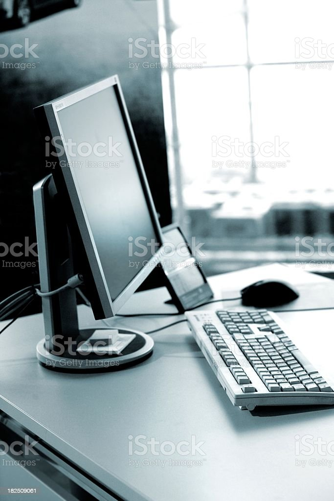 office desktop with screen, keyboard in daylight royalty-free stock photo