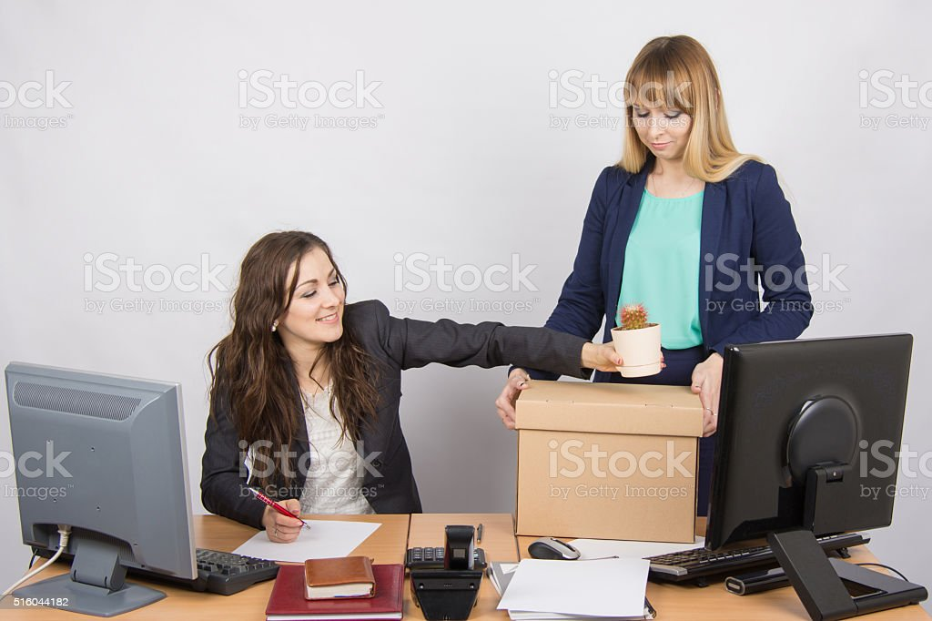 Office employee happily helps collect things sacked colleague stock photo