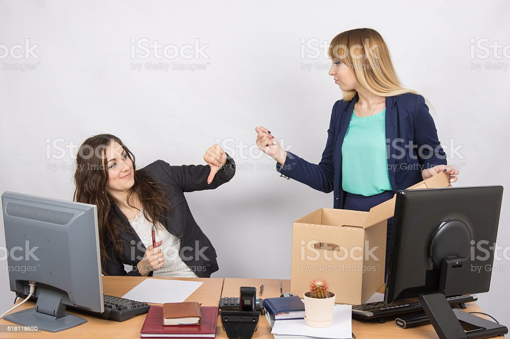 Office employee humiliating gesture of laid-off colleagues who fights back stock photo